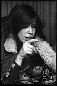 Thumbnail of Carly Simon, seated in a chair, wrapped in a winter jacket