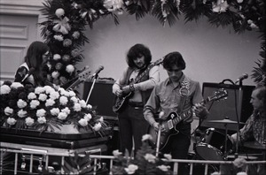 Thumbnail of Duane Allman's funeral: from left, Barry Oakley, Delaney Bramlett, Dickey Betts, and Butch Trucks, with Allman's casket in the foreground
