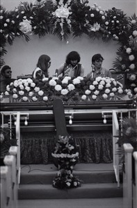 Thumbnail of Duane Allman's funeral: Allman Brothers Band performing, from left, Jaimoe, Barry Oakley, Delaney Bramlett, and Dickey Betts, with Allman's casket in the foreground