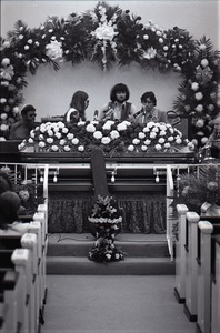 Thumbnail of Duane Allman's funeral: Allman Brothers Band performing, from left, Jaimoe, Barry Oakley, Delaney Bramlett, Dickey Betts, and Butch Trucks, with Allman's casket in the foreground
