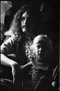 Thumbnail of Holy Modal Rounders at home: Richard Tyler seated with a child