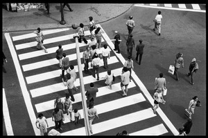 Thumbnail of Harvard Square: bird's-eye view, looking east, of people crossing the street by             the subway station