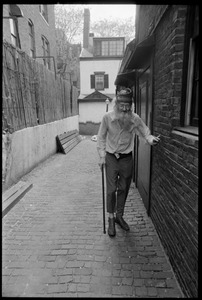 Thumbnail of Prescott Townsend walking with a cane up a Beacon Hill alley