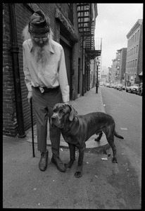Thumbnail of Prescott Townsend standing with a large dog on a Beacon Hill street