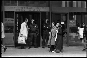 Thumbnail of Antiwar protesters picketing the entrance to the John F. Kennedy Federal Building as police stand by