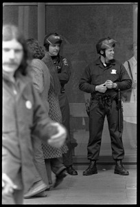 Thumbnail of Police look on as antiwar protesters picket the entrance to the John F. Kennedy Federal Building