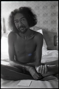 Thumbnail of Charles Lloyd sitting on a bed