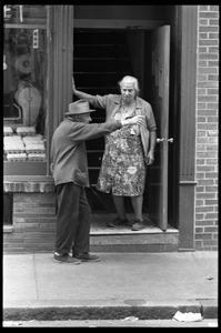 Thumbnail of Older man and woman talking in a doorway, Boston's North End