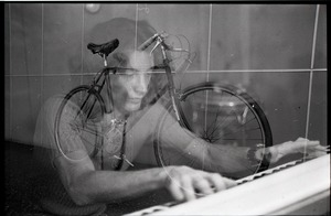 Thumbnail of Keyboard player and hand-made bicycle, double exposure