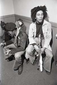 Thumbnail of Bob Marley and the Wailers at Paul's Mall: Marley backstage with Joe Higgs, Peter Tosh in the background