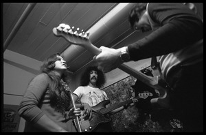 Thumbnail of Bonnie Raitt warming up backstage with Freebo (bass) and unidentified guitarist