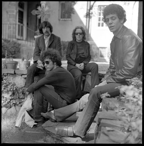Thumbnail of The  Velvet Underground: shot of the band posed in a Cambridge garden Clockwise from right: Lou Reed, Sterling Morrison, Doug Yule, Maureen Tucker