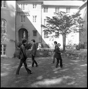 Thumbnail of The  Velvet Underground: shot of the band walking in circle in a Cambridge garden Left to right: Lou Reed, Doug Yule, Sterling Morrison, Maureen Tucker