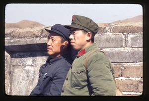Thumbnail of People's Liberation Army soldier and friend on Great Wall, graffiti on walls