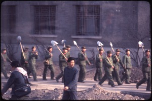 Thumbnail of PLA soldiers with shovels on their shoulders