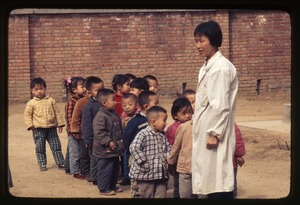 Thumbnail of General Petrochemical Works -- children lined up with teacher