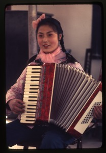 Thumbnail of Hsiao Ying Primary School -- girl with accordion