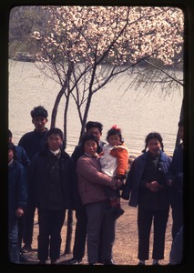 Thumbnail of Hsiao Ying Primary School -- Chinese people in front of flowering cherry tree at         lake