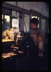Thumbnail of Long March Commune -- woman at Brigade factory