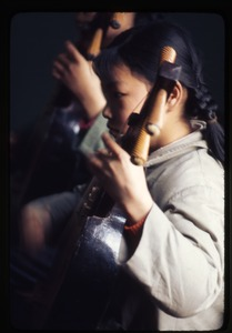 Thumbnail of Children's Palace -- girl playing instrument