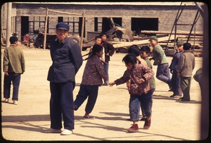 Thumbnail of Children in circle game -- male teacher