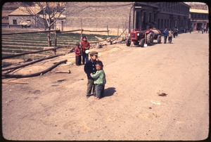 Thumbnail of Children in road, tractor