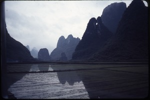 Thumbnail of Mountains, green fields, and paddy