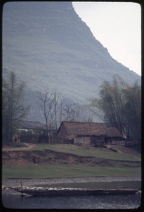 Thumbnail of House by riverside, at base of mountain
