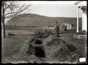 Thumbnail of Man digging trenches in front of Brooks-Fewell home (Greenwich, Mass.)