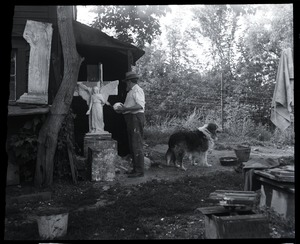 Thumbnail of Carlo Abate, with pet dog outside his studio