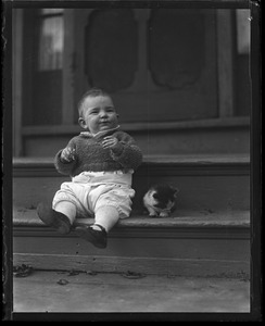 Thumbnail of Toddler sitting on a stoop with a kitten
