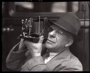 Thumbnail of Sam Connor and Bob Emery: man taking a picture with a Zeiss Ikon Super Ikonta camera