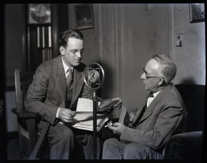 Thumbnail of Sam Connor and Bob Emery: seated during a radio broadcast