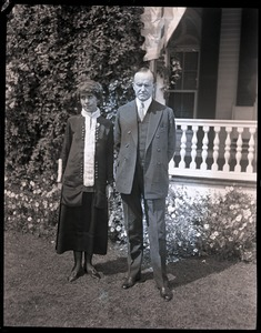 Thumbnail of Calvin and Grace Coolidge standing in front of a house