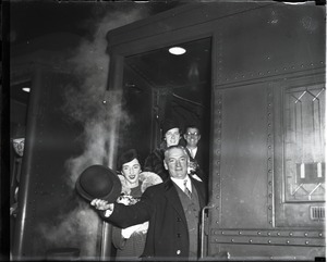 Thumbnail of James Michael Curley and wife Mary waving from a train