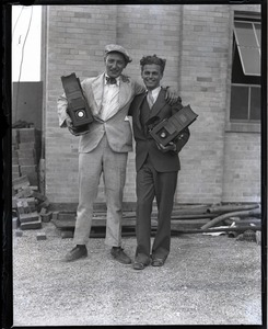 Thumbnail of Jack Dixon (left) and unidentified colleague posed with their Graflex cameras