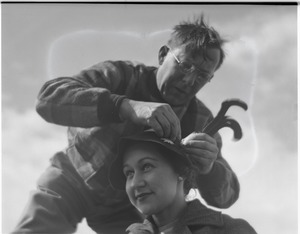 Thumbnail of Thomas Dreier fixing a feather in Blanche's cap