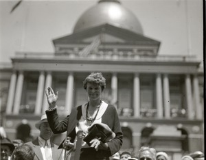 Thumbnail of Amelia Earhart reception: Earhart waving to the crowd in front of the          Massachusetts state capitol