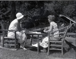Thumbnail of Dorothy Canfield Fisher: Fisher and unidentified woman, seated at a table outdoors