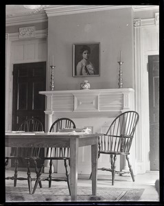 Thumbnail of Dorothy Canfield Fisher: interior of home, showing table with Windsor charis,          fireplace, and painted portrait of Fisher