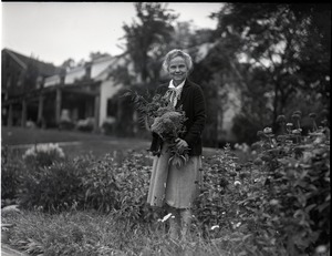 Thumbnail of Dorothy Canfield Fisher: Fisher in her garden with flowers