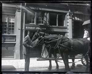 Thumbnail of Special Officer Jack Flavin feeding horses pulling a buggy in front of the Restaurant Ambassador
