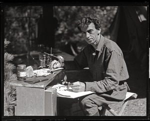 Thumbnail of Harry George Higbee, naturalist, at his field desk in the Moose Hill Wildlife Sanctuary