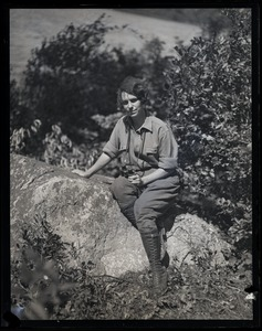 Thumbnail of Elsie L. Higbee, seated on rocks in the Moose Hill Wildlife Sanctuary