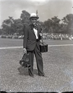 Thumbnail of Franklin I. Jordan, photographer, wearing a festive hat and tie, with cameras