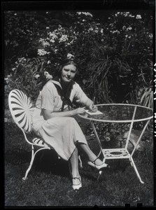 Thumbnail of Dorothy Thompson Portrait seated at a table: 'Yellow printer': 3-part yellow-red-blue separations intended for early color          printing. In 1939 Time magazine called Dorothy Thompson the 'cartwheel girl' for her          ability to overturn ideas, recognizing her as the second most influential woman in America.          Pictured in the garden of the Sinclair Lewis Vermont home