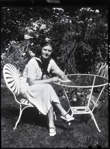 Thumbnail of Dorothy Thompson Portrait seated at a table: 'Red printer': 3-part yellow-red-blue separations intended for early color          printing. In 1939 Time magazine called Dorothy Thompson the 'cartwheel girl' for her          ability to overturn ideas, recognizing her as the second most influential woman in America.          Pictured in the garden of the Sinclair Lewis Vermont home