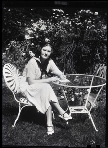 Thumbnail of Dorothy Thompson Portrait seated at a table: 'Blue printer': 3-part yellow-red-blue separations intended for early color          printing. In 1939 Time magazine called Dorothy Thompson the 'cartwheel girl' for her          ability to overturn ideas, recognizing her as the second most influential woman in America.          Pictured in the garden of the Sinclair Lewis Vermont home