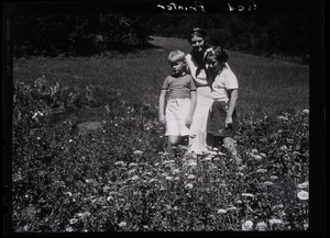 Thumbnail of Dorothy Thompson, her son Michael Lewis, and unidentified girl standing in a field       of flowers 'Red printer': 3-part yellow-red-blue separations;          pictured in the garden of the Sinclair Lewis Vermont home