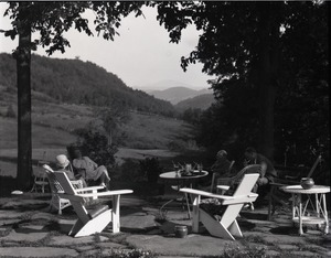 Thumbnail of Sinclair Lewis (far right), Dorothy Thompson (2nd from left), and guests Seated on their patio, overlooking fields and hills